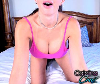 Catalina Cruz large tits popping out of her pink body suit