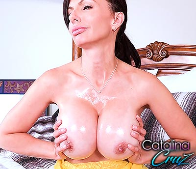 Catalina Cruz hot oil all over her juicy breasts and massaging them