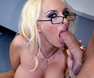 Holly Halston in glasses sucking a big cock and titty fucking
