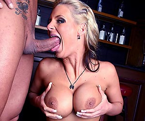 Phoenix Marie on her knees with a nice big cock in her mouth