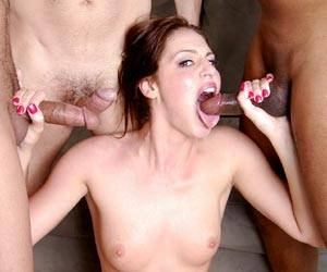Lauren Phoenix blowing 3 hard cock together
