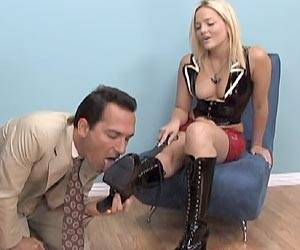 Alexis Texas stroking a cock with her feet